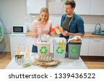 waste sorting at home. smiling... | Shutterstock . vector #1339436522