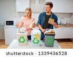 waste sorting at home. smiling... | Shutterstock . vector #1339436528