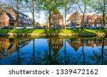 european city river houses...   Shutterstock . vector #1339472162