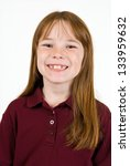 Young Caucasian female in school polo shirt - stock photo