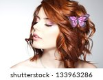 pretty woman with a butterfly... | Shutterstock . vector #133963286
