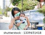 asian mother carrying her...   Shutterstock . vector #1339651418