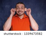 the cheerful man pretends to be ... | Shutterstock . vector #1339673582