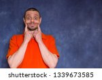 the cheerful man pretends to be ... | Shutterstock . vector #1339673585