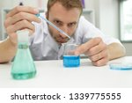 male chemist experimenting in... | Shutterstock . vector #1339775555