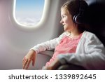 adorable young girl traveling... | Shutterstock . vector #1339892645