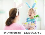 mother and kids color easter...   Shutterstock . vector #1339902752