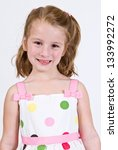 Young Caucasian girl in a polka dot dress - stock photo