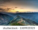 View of Dinosaur backbone Ta Xua, Bac Yen, Son La, Vietnam. Sunrise, mountain hill path road panoramic landscape