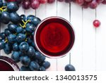 two glasses of red wine and... | Shutterstock . vector #1340013575
