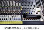 Over view on sound mixer with regulation buttons - stock photo