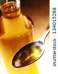 olive oil on spoon and bottle... | Shutterstock . vector #134015288