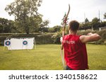 male archery instructor with... | Shutterstock . vector #1340158622