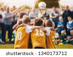 kids holding golden cup. boys... | Shutterstock . vector #1340173712