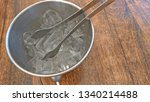 ice in a silver bucket. on a... | Shutterstock . vector #1340214488