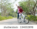 Senior Couple Bicycling...