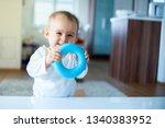 Caucasian Baby Girl Standing...
