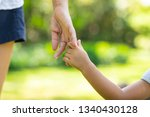 mother's and child hold hands.... | Shutterstock . vector #1340430128