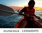 guy in kayaks in the sea at... | Shutterstock . vector #1340600495