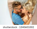 couple in love hugging at home... | Shutterstock . vector #1340601002