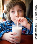 young boy drinking a glass of... | Shutterstock . vector #134067002