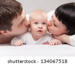 happy young family with baby.... | Shutterstock . vector #134067518