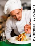 chef adding finishing touch to... | Shutterstock . vector #134081645