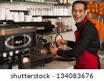 Cheerful male staff preparing customers order. - stock photo