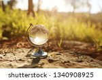 small crystal globe in front of ... | Shutterstock . vector #1340908925
