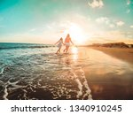 mother and daughter running... | Shutterstock . vector #1340910245