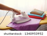 the woman the housewife irons... | Shutterstock . vector #1340953952