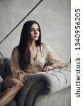 alluring model in beige laced... | Shutterstock . vector #1340956205