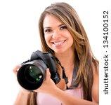 Happy Female Photographer With...