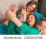 two young beautiful smiling... | Shutterstock . vector #1341013748