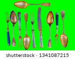 vintage cutlery on a green... | Shutterstock . vector #1341087215