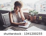 young business woman sitting at ... | Shutterstock . vector #1341200255