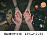 Small photo of Palmistry concept. Fortune teller reading future on the hand on a magic table background. Future reading concept.