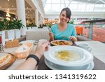couple eating in cafe. point of ... | Shutterstock . vector #1341319622