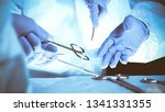 surgeons hands holding surgical ... | Shutterstock . vector #1341331355
