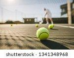tennis balls lying on the... | Shutterstock . vector #1341348968