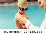 woman putting sleeves floats on ...   Shutterstock . vector #1341351998