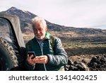 caucasian old man use modern... | Shutterstock . vector #1341402425