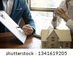 businessman signs contract...   Shutterstock . vector #1341619205