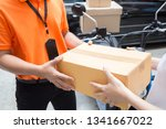 woman hand accepting a delivery ... | Shutterstock . vector #1341667022