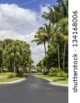 Road to gated community buildings in Naples, Florida - stock photo