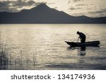 Silhouette Of A Fisherman In A...