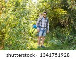 Stock photo adventures summer tourism and nature concept tourist arriving to a camping with his cat 1341751928