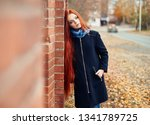 woman with long red hair walks... | Shutterstock . vector #1341789725