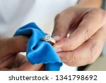 jeweller hand polishing and... | Shutterstock . vector #1341798692