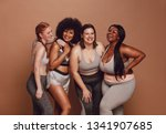 smiling group of women in... | Shutterstock . vector #1341907685